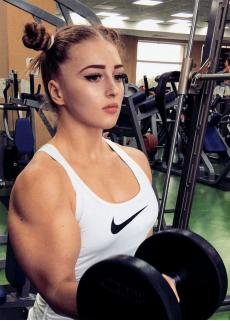 getInterUrl?uicrIvZQ=920f3f8d7be4e62ef9466a6a2afffec9 - Russian beautiful girl breaks the world weightlifting record, has huge biceps, and becomes a real King Kong Barbie